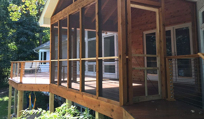screened in porch next to new deck